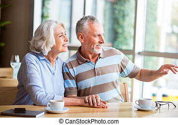 Pleasant senior loving couple resting in the cafe - Have a...