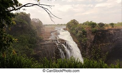 The Victoria falls with mist - The Victoria falls, largest...