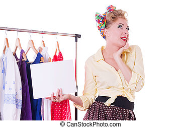 Pin-up woman holding blank note over hanger and dresses...