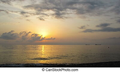 Sunset Over the Sea. Time Lapse - Sunset over the sea with...