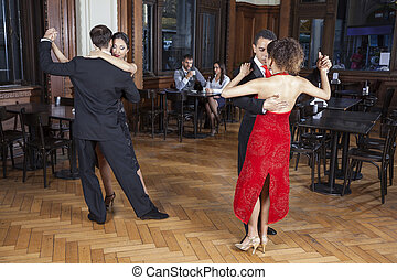 Tango Dancers Performing While Couple Dating In Restaurant -...
