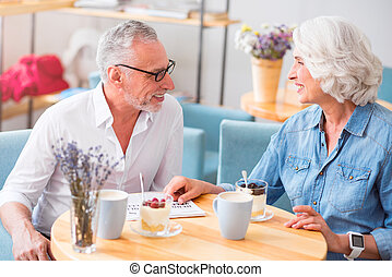 Cheerful couple resting in the cafe - Share ideas. Positive...