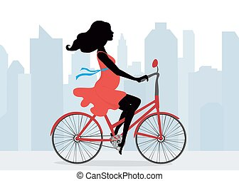 Pregnant woman rides a Bicycle on the background of the city
