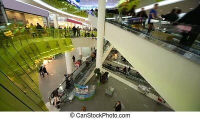 people customers moving on escalators in big mall shop, wide angle