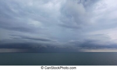 lighting from dark storm clouds above waving Black Sea