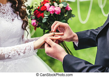 Bride and groom puts ring - wonderful stylish rich happy...