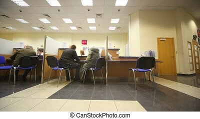 sitting in chairs clients during consultation in bank