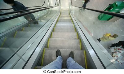 camera moving down on escalator, top view