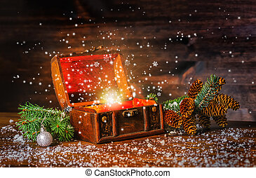 Christmas winter fairy with fantasy miracle in opened chest treasure. Background of mystery gift New Year, fir tree and snow. Greeting card concept, close up