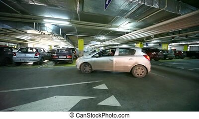 cars turning on crossing in underground car park