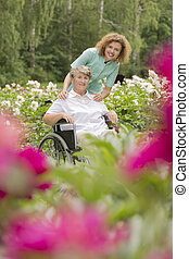 In the garden of flowers - Shot of a senior lady in a...
