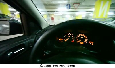 view from car\'s side window to underground car park