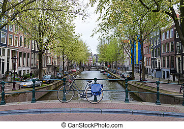 Bicycle lining a bridge over the canals of Amsterdam,...