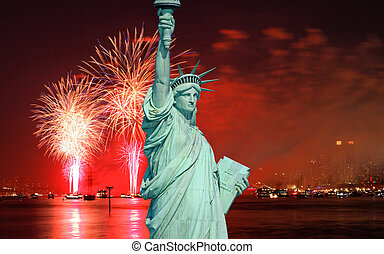 The Statue of Liberty and July 4th fireworks over Hudson...