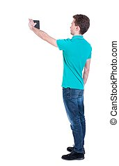 back view of standing business man photographing a phone or...