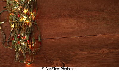 flashing garland on the wooden floor Christmas background