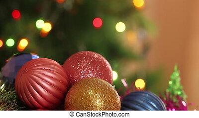 Christmas balls and fir tree with garland flashing....