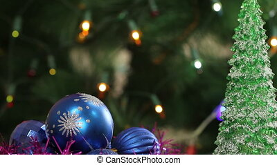 Christmas balls and fir tree with garland flashing...