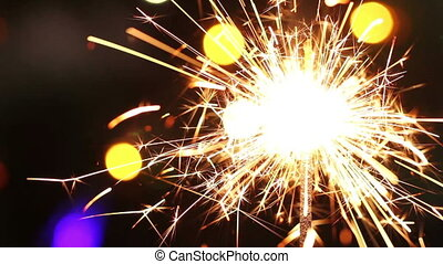 burning sparkler on background blinking blurred garland hd