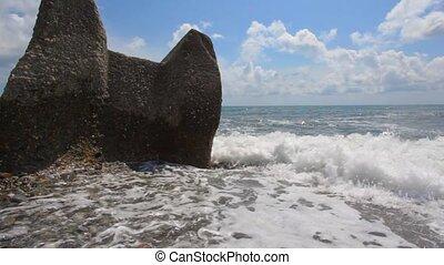 sea surf waves break against the rock