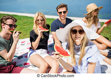 Happy picnic - A photo of young, beautiful woman picnicking...