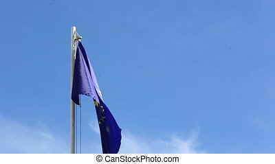 Flag of European Union in front of blue sky - Flag of...