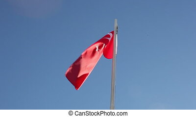 Request Turkey flag in front of blue sky