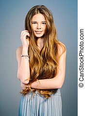 rich long hair - Beautiful girl with shiny long hair smiling...