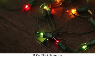 flashing garland lying on the wooden floor Christmas...