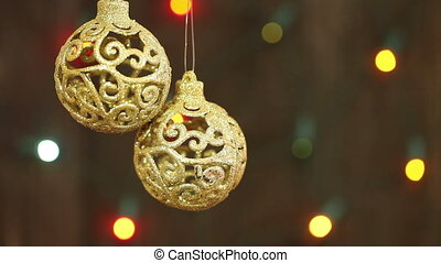delicate golden balls on the background of garlands...
