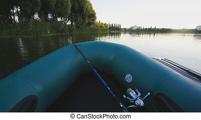fishing on a lake from rubber boat first-person view - Young...