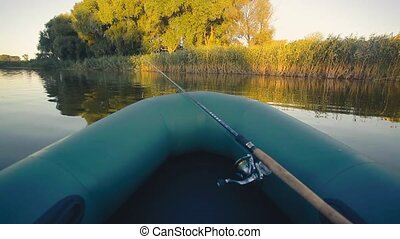 fishing on a lake from rubber boat. first-person view -...