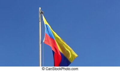 Textile flag of Venezuela on a flagpole