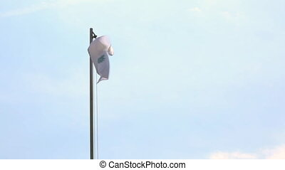 Textile flag of Cyprus on a flagpole