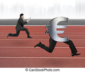 Man running after Euro money symbol with human legs on red...