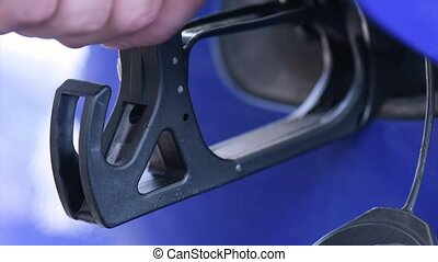 Filling fuel into car - Close up shot of filling fuel into...