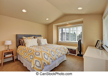 Vaulted ceiling bedroom interior in beige colors