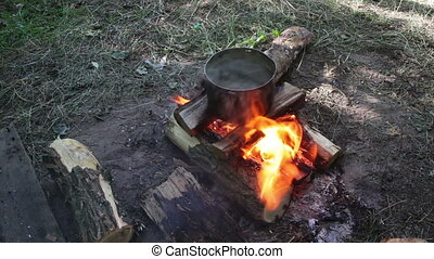 Cooking Food over a Campfire at the Tourist Pot - Cooking...