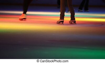 headless people skating in skating rink with illumination