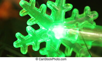 flashing light garlands in the form snowflakes. HD