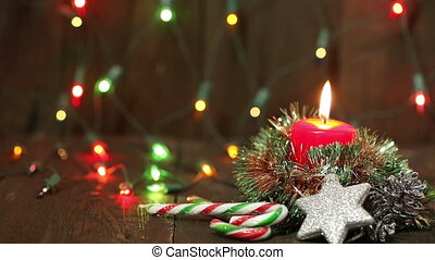 one burning candle and Christmas decorations Background