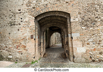 The entry to the castle Scaliger in old town Sirmione on...
