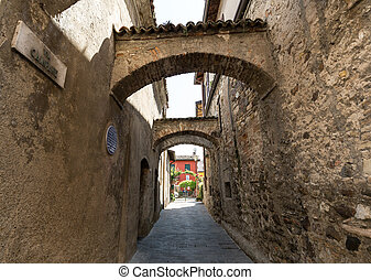 Picturesque narrow town street  in Sirmione, Lake Garda Italy.