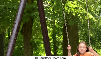 Girl on chain swings - Adorable happy little girl on chain...