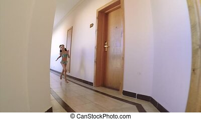 Little girl running - Happy child running in the hotel...
