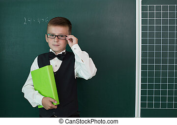 Happy pupil with schoolbook - Happy pupil with glasses...