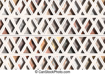 Wall with triangles of different materials in white frames -...