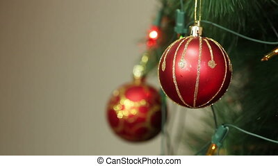 Red ball hanging on a Christmas tree HD