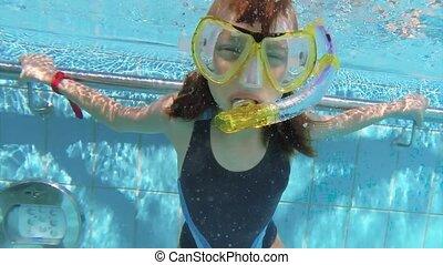 Underwater girl in aquapark - Happy little girl wearing...