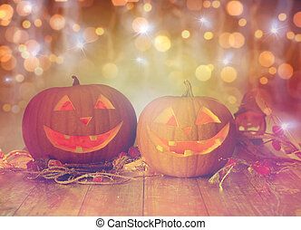 close up of carved halloween pumpkins on table - holidays,...